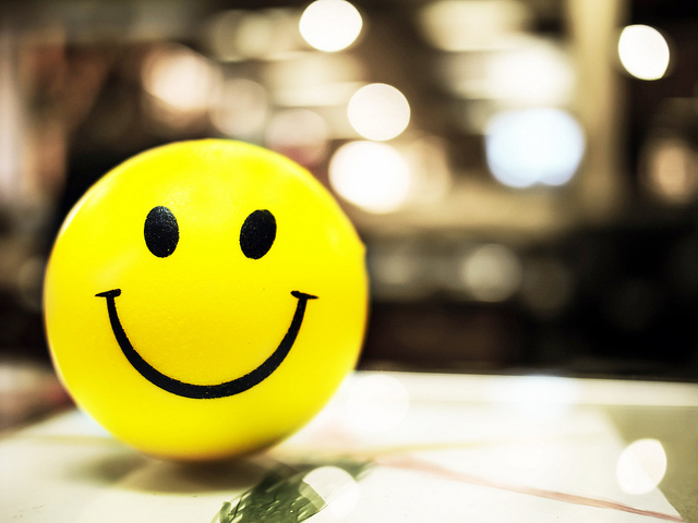 7 Ways to Put on a Happy Face at Work - A Career Booster